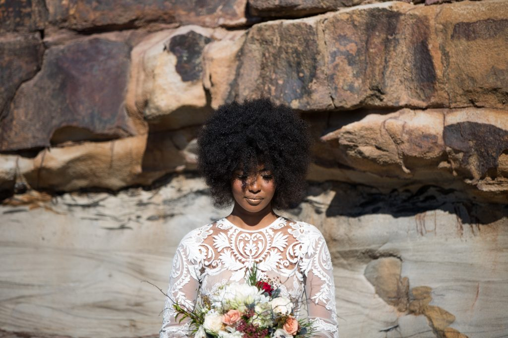 African bride with afro, metallic makeup and lace When Freddie met Lilly dress