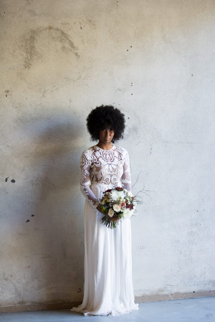 African bride with afro, wearing lace long sleeve wedding dress by When Freddie met Lilly